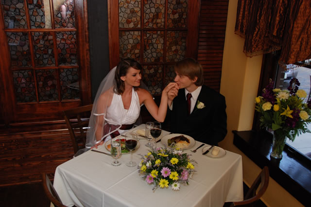 Wedding couple sitting at dinner table