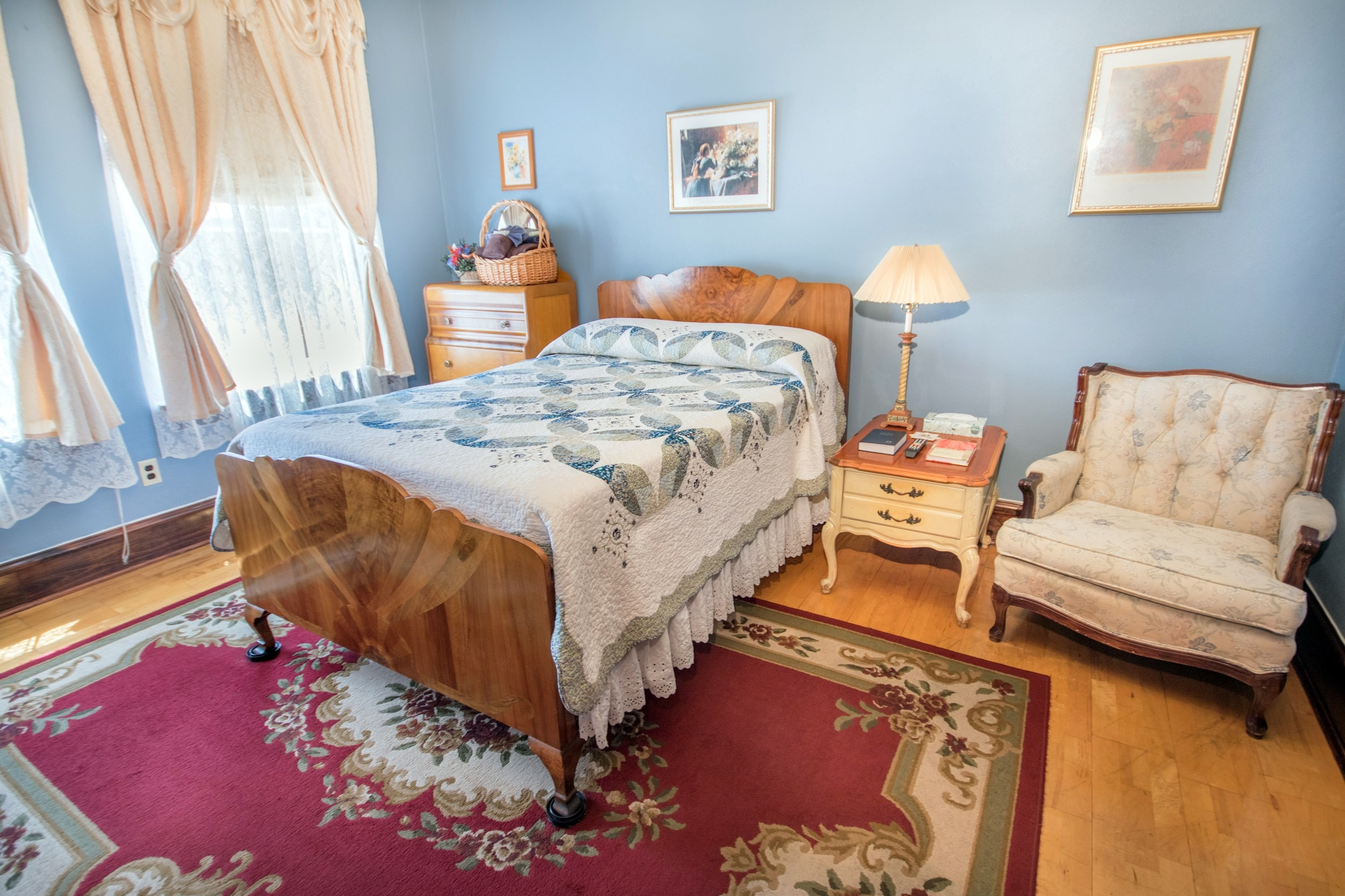 Hotel room with hardwood floors and blue walls