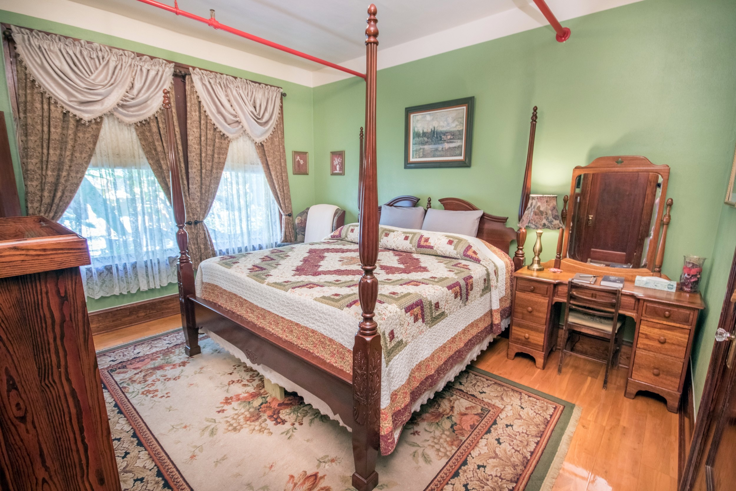 Room with green walls and bed